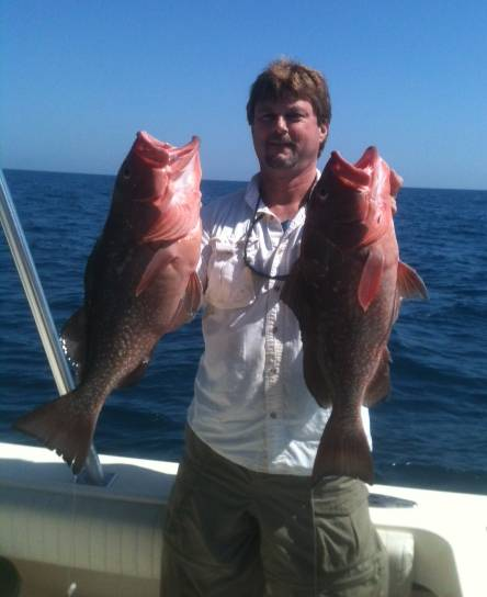 Captain John With Two Red Groupers