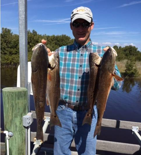Mr. Davis with some nice Cedar Key Reds