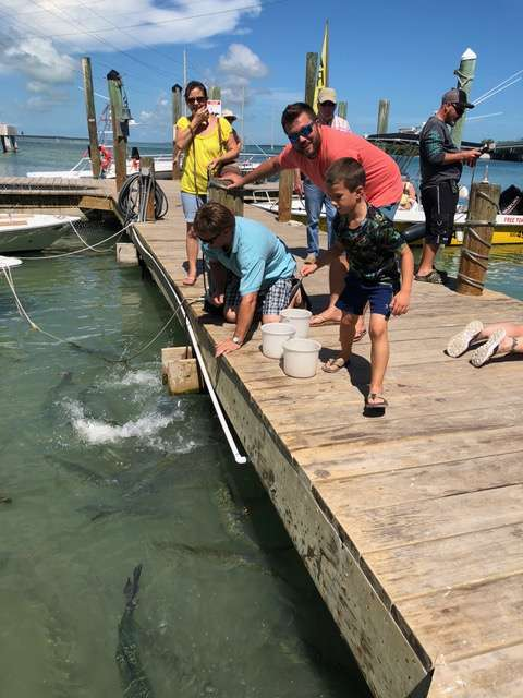 Captain John on vacation feeding tarpon