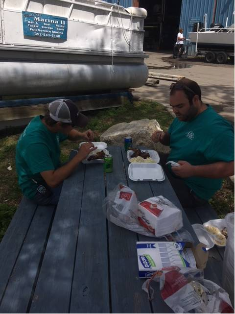 A & K  getting 1st dibs at the marina cookout