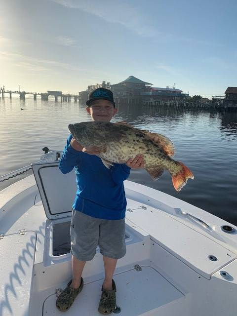 Easton with a whopper of a grouper, caught with Captain Dennis