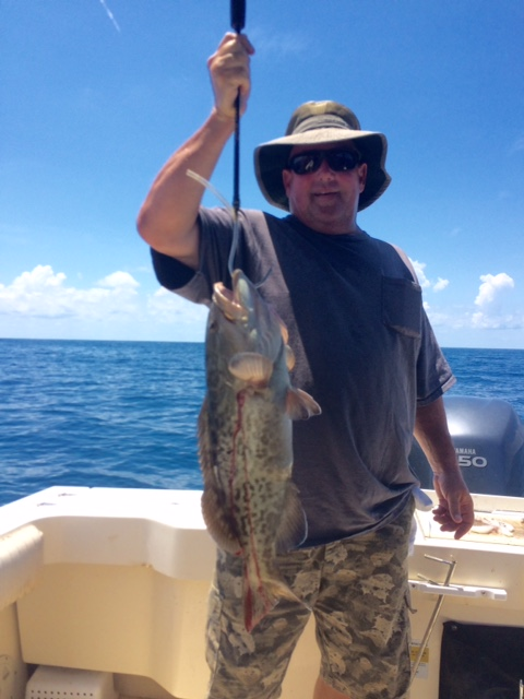Jeff just showing off his Cedar Key, Florida Gag Grouper to Shelia