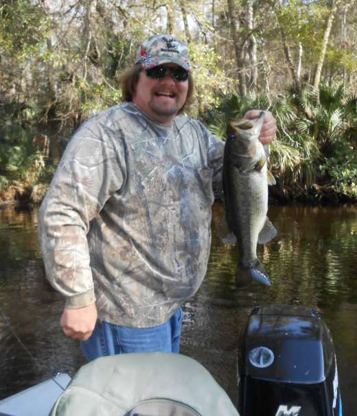 Smiles and an Ocklawaha Bass. Also caught with Slick Charters