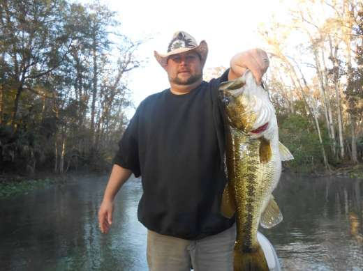A Slick Charters customer with a 7.5 lb. Bass