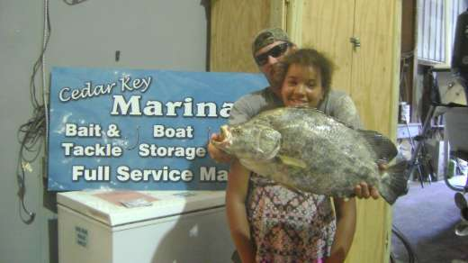 A Cedar Key Marina Customer With A Huge Tripletail
