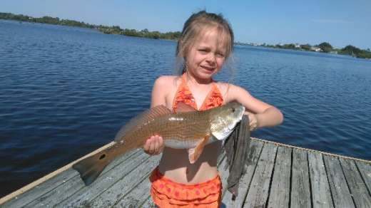 Little Miss. Bell out fishing her dad with this nice redfish