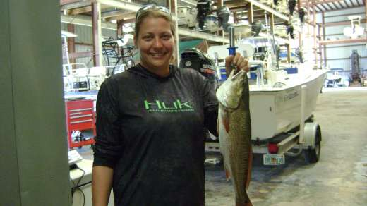 Melissa weighing in her Redfish at 4.2lbs for her chance to win