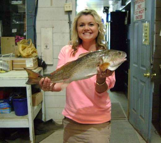 Mrs. Chandler showing off now, weighing her Redfish for the big fish contest, 2.4lbs