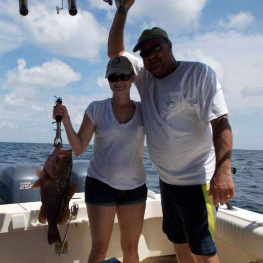 Ron and daughter Amanda with a nice grouper caught with Capt. John of Hooked Up Charters