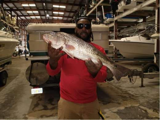 Cedar Key Marina Customer With A Fine Redfish