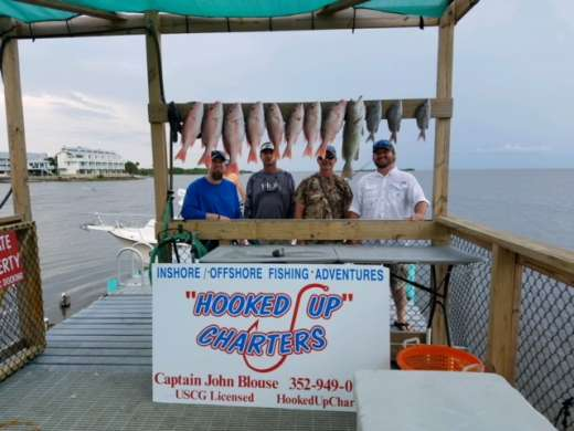 Burnsed crew with a nice catch on a  rough day with Captain John