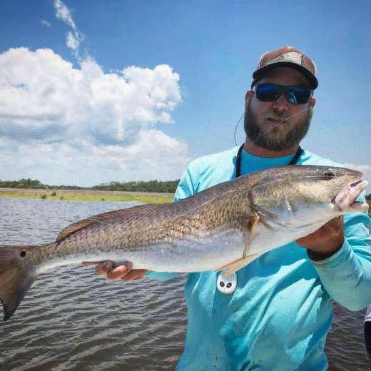 Captain Kyle showing off a whooper of a Redfish
