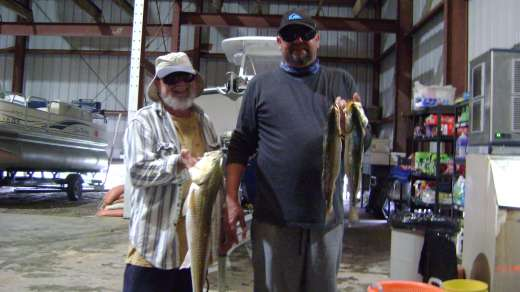 Frank & son with a nice Redfish and Speckled Trout for dinner