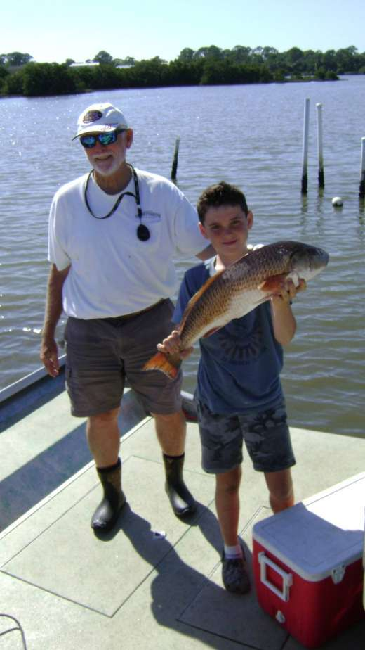 Sportin a big ole Redfish, nice catch guys