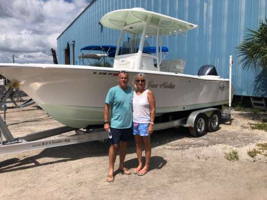 The Killhams with their new used boat purchase from Cedar Key Marina II, happy couple