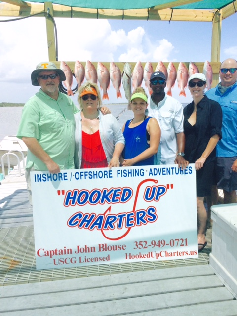 The Hall gang, with a nice catch for a day with Captain John