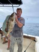 Captain John sporting a nice Gag Grouper on a Hookedup Charters trip