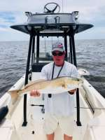 Greg with a whopper Redfish