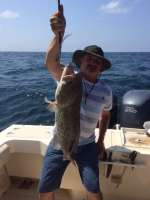 "Mark with Ocala Auto Masters crew, caught this 30"" Gag Grouper with Capt John"