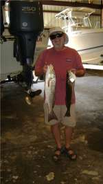 Merillat 2.6lb trout and 4.85lb red