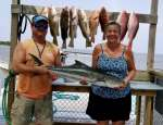 SUSAN SHOWING OFF HER NICE COBIA W CAPT JOHN