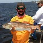 Travis with an awesome Cedar Key Redfish