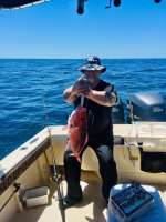 Ben w a nice slab Snapper, released unharmed w Capt John
