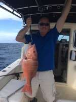 Cyrstal's crew mate w a monster snapper, caught w Captain John