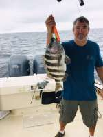 Dennis with a monster 12 lb Sheepshead, caught with Captain John