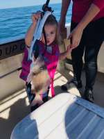 Captain Johns Granddaughter with her first catch
