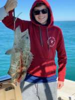 John M with his 1st grouper with Capt John