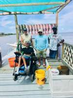 Justin's crew with a good catch on a rainy day w Capt John