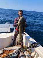 Mark holding a monster Cobia, we hope you're hungry