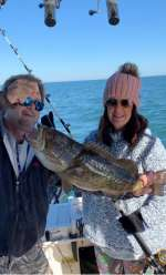 Mrs. M. with her first grouper with Captain John