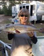 Patty with Christmas dinner, nice catch w hubby Roge