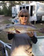 Patty with Christmas dinner, nice catch w hubby Roger