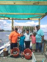Uncle Jed and crew with Captain John Nice catch guys
