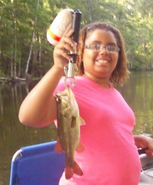 11 year Old Alexis Showing Off An Early Morning Ocklawaha Largemouth Bass.