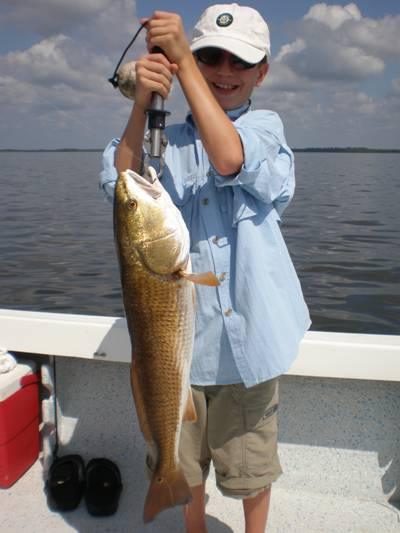 He caught this nice Red with Captain Steve and now he's waiting for mama to clean it
