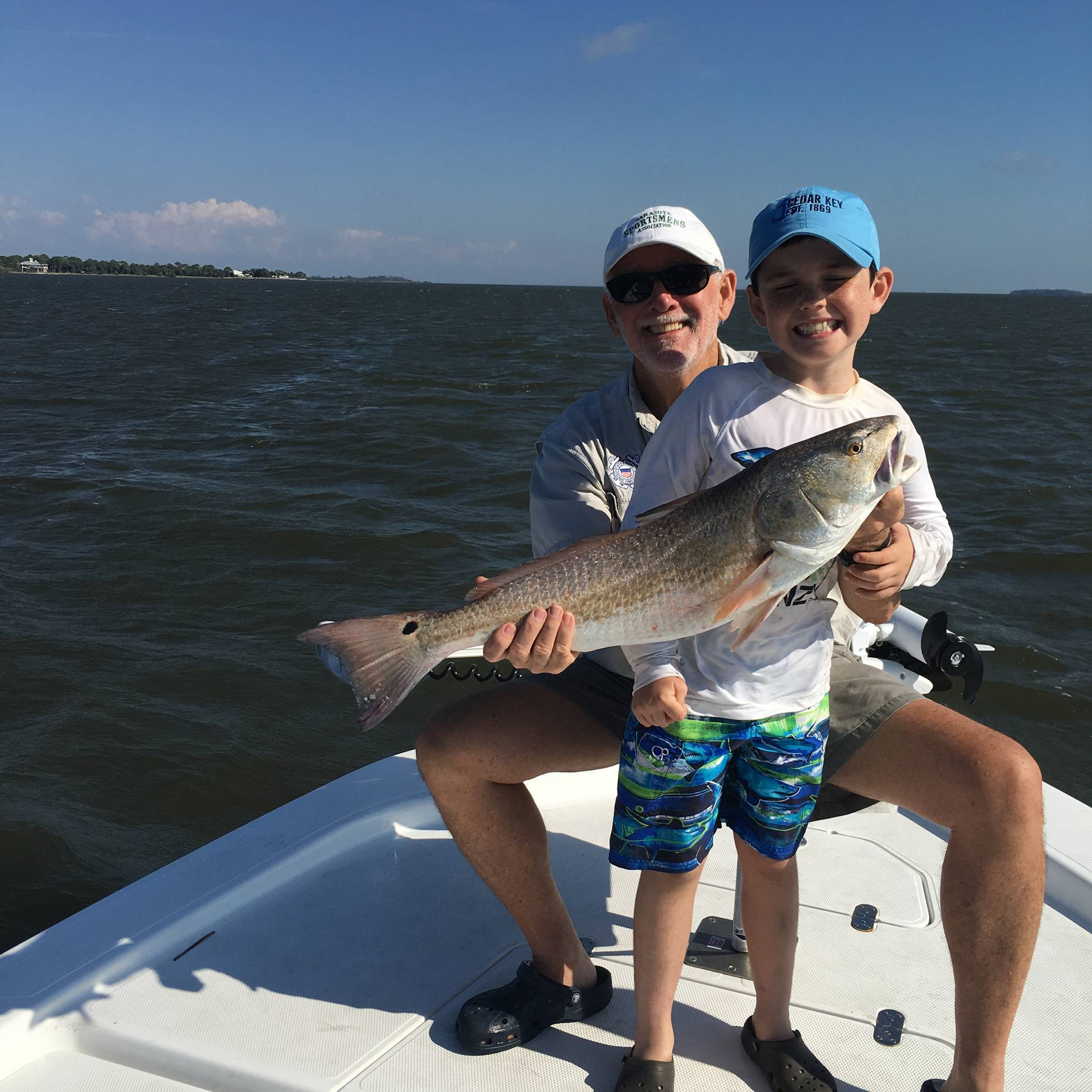Dad and son with an awesome redfish
