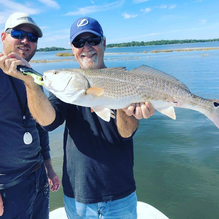 Captain Kyle & Dad Enjoying The Day Together Catching Some Nice Reds