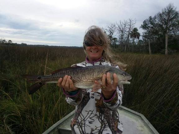 Patty with a nice Cedar Key Redfish showing Roger how its done