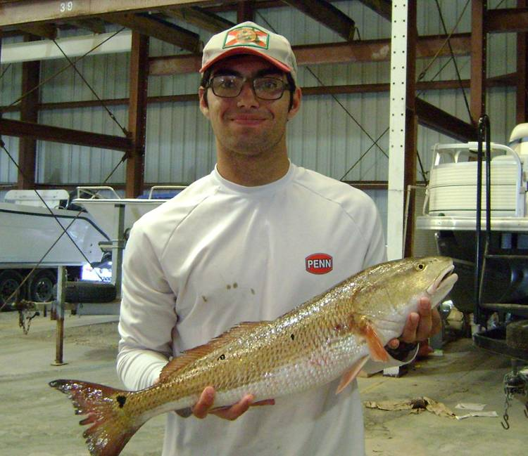 Mr. Cooley weighing in his Redfish at 6.3lbs for the big fish contest