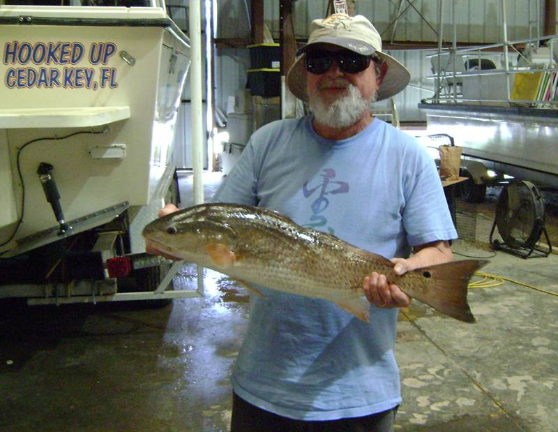 Mr F. with a huge Redfish, daaaaang nice one
